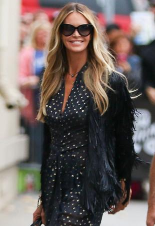 Elle MacPherson wearing a polka dot jumpsuit.