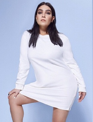 Plus Size Blogger Nadia Aboulhosn models a white dress from her Boohoo collection