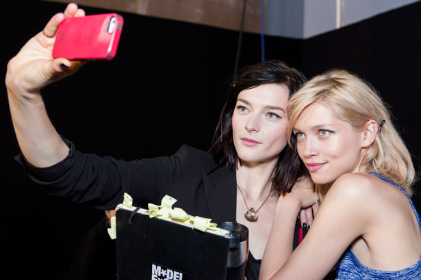 models taking a selfie