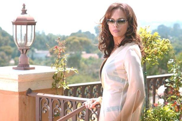 Melinda Clarke as Julie Cooper