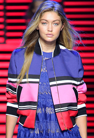 Gigi Hadid models a bomber on the Elie Saab Spring 2016 runway, a natural choice for the athleisure enthusiast.