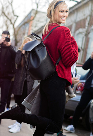 Karlie Kloss sports a black Mansur Gavriel backpack in Milan.