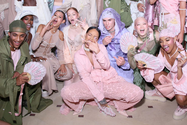 Rihanna is seen with models backstage during FENTY x PUMA by Rihanna at Hotel Salomon de Rothschild on September 28, 2016 in Paris, France