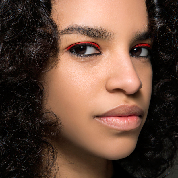 Model with red lipstick worn as eyeshadow and black eyeliner