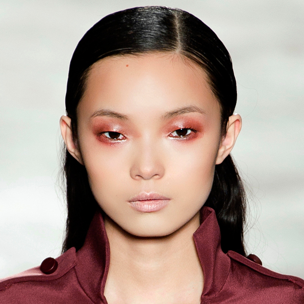 Model with glossy red lipstick as eyeshadow