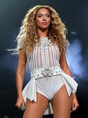 "Beyoncé onstage during her 2013 ""Mrs. Carter Show World Tour."""