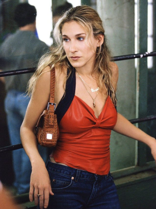 "Going-out tops and jeans are back, as seen on Carrie Bradshaw (Sarah Jessica Parker) on ""Sex and the City."""