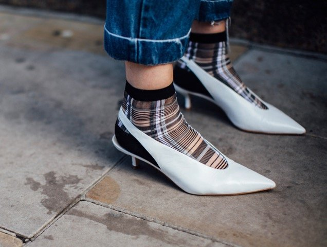 Sheer socks and plaid: two must-haves for 2018.
