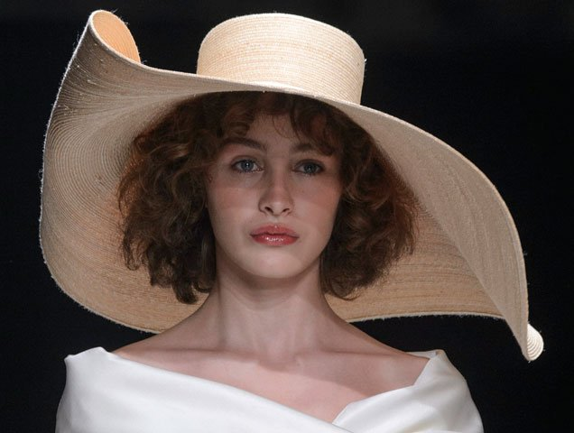 Oversized floppy hat on the Valentin Yudashkin Spring 2018 runway
